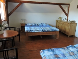 room with 1 doublebed and children bed